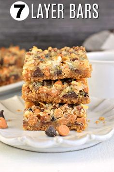 The BEST, Easy Seven Layer Cookie Bars Recipe 7 Layer Cookie Bars Recipe topped with coconut, pecans, chocolate and butterscotch. You'll love this easy Magic Bar recipe any time of year! Köstliche Desserts, Delicious Desserts, Dessert Recipes, Bar Recipes, Recipies, Yummy Food, Sweet Desserts, Yummy Yummy, Dinner Recipes