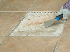 DIYNetwork.com has instructions on how to remove and patch a section of damaged tile flooring.