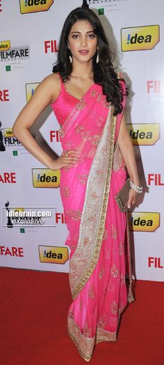 If you're young and pretty like Sruthi, you can't really go wrong with a rich pink saree, can you?