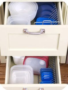 Tupperware organization with a CD rack.  Use cable hooks to elevate.