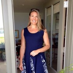 I fell in love with this dress as I was sewing it for my darling daughter. Love the color...why is it so difficult to find a great navy dress???  Love the stretch lace godets which allow the close-fitting bodice to flow into a beautiful flared skirt.