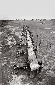 Royal Flying Corps pilots assemble with their S.E.5a Scouts, one of the fastest aircraft of the war.: