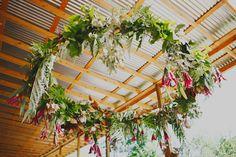 hanging floral wreath pink flowers  wedding decor  via lucysaysido.com