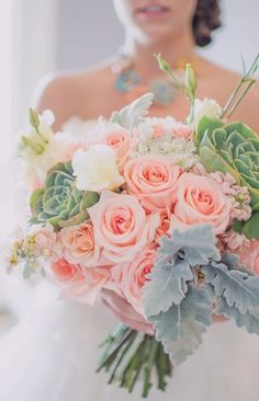 Peach rose, green succulent, and sage green foliage bouquet.