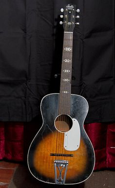 """Harmony Stella H929 with stenciled fret markers, a metal tailpiece and 18 frets.The Stella guitar brand was acquired by the Harmony company in 1939. Production years for the model H929 were 1945-1970. The white plastic pick guard dates this post-1961. Elvis Presley used a Stella H929 in the movie """"Jailhouse Rock""""    numerous dings, dents, retouches, blemishes. One of the strap hooks has been replaced.    For more details please reference all the picturesIncludes a hard case (non origi"""