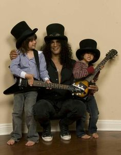 """Slash of Guns n Roses, with his two rocker small kids  """"The World's No:1 Online Heavy Metal T-Shirt Store"""". Check it out NOW; www.HeavyMetalTshirts.net"""