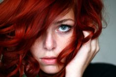 Red hair and green eyes.