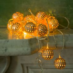 Geometric cutouts cast a lacy pattern from this garland of polished metal bulbs in white, silver, or bright copper. - Geometric Pin Dot Lights in HOLIDAY Lighting at Terrain Globe Lights, Holiday Lights, Christmas Lights, Holiday Decor, Christmas Garlands, Christmas Decor, Arabesque, Balcony Lighting, Copper Lighting