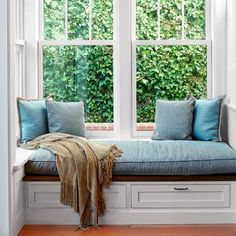 "window seat with storage drawers below and a ledge --- links to a This Old House article titled, ""All About Window Seats"""