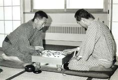 "Toshio Ikeda (on the left), Fujitsu General Manager and Go (Japanese chess) expert, known as ""Mr Computer"" in Japan and instrumental in designing FACOM 100, Japan's first practical relay type scientific computer.  Famous for being quite eccentric and inclined to hold meetings in coffee shops."