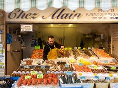 Photo: Man at fish market in France- Trouville's daily fish market