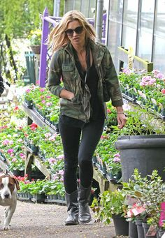 Kate Moss balanced a cool camouflage jacket with black basics while walking her dog in London.