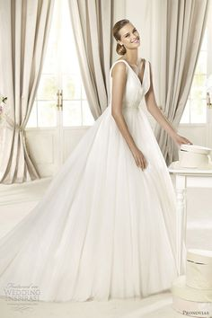 Pronovias Glamour Collection Dafnis. V-neck chiffon ballgown with pearl beaded waist band. Even as a ball gown, this would still keep a nice airy, summer feeling.
