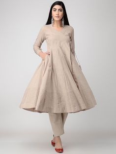 Beige Cotton Slub Angrakha with Pintucks Designer Party Wear Dresses, Kurti Designs Party Wear, Indian Designer Outfits, Simple Pakistani Dresses, Pakistani Dress Design, Pakistani Clothing, Shadi Dresses, Indian Gowns Dresses, Frock Fashion
