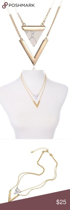 Lily + Arrow Signature Layered Necklace The Lily + Arrow Signature Layered Necklace is an elegant gold zinc-alloy faux-marble necklace. On trend for Summer 2017. Marble patterns vary with each individual necklace. Jewelry Necklaces
