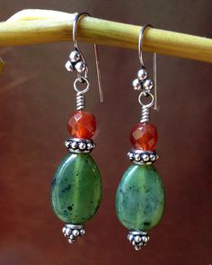 These handmade jade and carnelian earrings are adorable and will be a great compliment to other silver pieces in your jewelry collection. They are made using sterling silver bali beads and ear wires.
