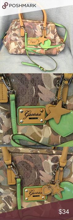 Super Cute Guess Purse Guess Purse in Excellent Condition, very clean!! Purse Measures 13 X 9 with 8.5 in Drop. Shoulder Strap measures 20.5 inches! There is one thread lose near the zipper please see last photo! Colors are a pretty mint green, tans and Brown. Guess Bags