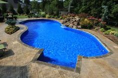 Large Lagoon Style Swimming Pool                                Pages