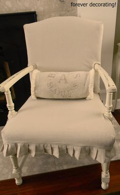 Great shabby chair slipcover. The wood of this chair was stained brown before its makeover.