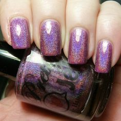 Redivivus is mid-toned red plum with a strong linear holo.