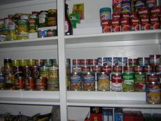 Can stackers on pantry shelf to organize can goods.