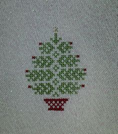 """You are bidding on an adorable completed cross stitch. It is """"Nordic Tree"""" by JBW Designs. It is stitched on 28 ct Opalescent Jobelan. The fabric measures approximately 4 1/4"""" x 4 1/2"""" and the design measures approximately 1 3/4"""" x 2 1/2"""". This would make an adorable ornament for your tree. Although my pieces are new, I always state For sale as is as shown. All of my pieces come from a smoke free home! Take a look at my other auctions as I wil..."""