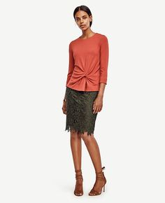 Twist+knot+detail+puts+a+modern+spin+on+this+silhouette+slimming+top,+cast+in+the+season's+most+coveted+colors.+Jewel+neck.+3/4+sleeves.+Hidden+back+zipper+with+hook-and-eye+closure.