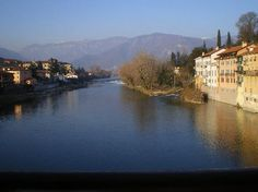 Bassano Del Grappa, Italy. The view from this bridge is absolutely amazing - this picture doesn't even do the colors and architecture justice.