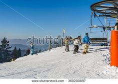 Wierchomla Mala, Poland - January 02, 2016: Three snowboarders begins to exit left with the chairlift.  - stock photo