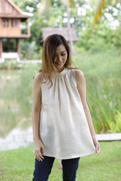 Add a touch of freedom to your closet with our premium breezy style Fleur Linen Silk Sleeveless Blouse