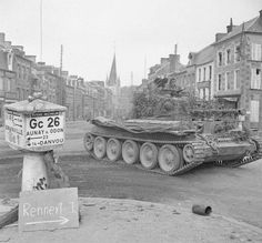 A Cromwell tank of Northamptonshire Yeomanry, Armoured Division, driving through Vassy, France, 15 August Churchill, Cromwell Tank, Canadian Army, British Army, D Day Normandy, Tank Armor, Military Armor, Armored Fighting Vehicle, Military Pictures