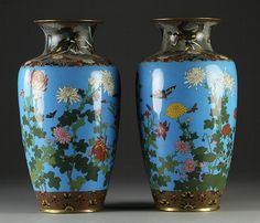 "Pr. Japanese Finely Enameled Cloisonné Vases Depicting lotus blossoms and butterflies against a blue ground, both measure 16""H, circa late 19th-early 20th century."