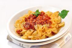 italian pasta - farfalle with meat and tomato sauce