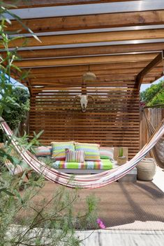 wood slat patio shade structure, with hammock