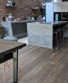 The dark wood flooring in this kitchen defines the dining and living areas. - The dark wood flooring in this kitchen defines the dining and living areas. The room features a ti - Cheap Wood Flooring, Wide Plank Flooring, Hardwood Floors, Flooring Cost, Linoleum Flooring, Vinyl Flooring, Wooden Floor Tiles, Dark Wooden Floor, Stairs Cladding