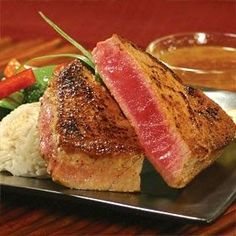 Marinated Tuna Steak Recipe This tuna steak was insanely good..!! INGREDIENTS : 1/4 cup orange juice 1/4 cup soy sauce ...