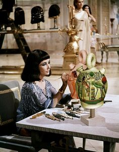 CLEOPATRA - Elizabeth Taylor as 'Cleopatra' paints a piece of pottery - Produced by Walter Wanger Joseph L. Manciwietz - Directed by Joseph L. Manciwietz - Century-Fox - Publicity Still. Old Hollywood Stars, Hooray For Hollywood, Golden Age Of Hollywood, Vintage Hollywood, Hollywood Glamour, Classic Hollywood, Hollywood Style, Vintage Vogue, Elizabeth Taylor Cleopatra