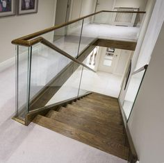 The fixing bolts on this glass staircase are completely hidden, resulting in a seamless look. #Staircase #GlassProcessing