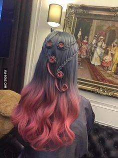 Hair dye. I'm not usually a fan of rainbow hair, but this is pretty cool.