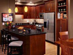 Kitchen Cabinet Designer black granite countertops in a classic wooden kitchen with kitchen