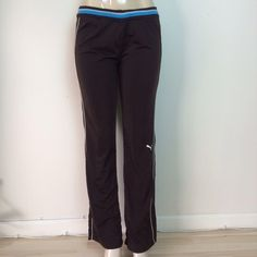 PUMA brown athletic workout track sweatpants S PUMA chocolate brown white blue line athletic workout track sweatpants S  Add this to your fitness wear!   Comfy brown track pants from PUMA with turquoise and white lines on the side, waistband and logo on the left pant leg.  Has a tie on the inside to better cinch your waist.  EXCELLENT CONDITION Puma Pants Track Pants & Joggers
