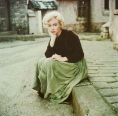 Milton H. Green, Marilyn 'peasant' sitting on a curb, 1954.<br>