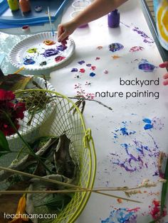This nature painting idea is so much fun for the spring time! Collect flowers, twigs, grasses, etc from the backyard and paint with them!  #teachmama #spring #springcrafts #painting #outdoors #summerfun #kidsactivities #outdooractivities #backyardactivities