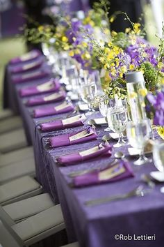 purple tablecloths, yellow centerpieces. Having some light gray somewhere in there would be nice also.