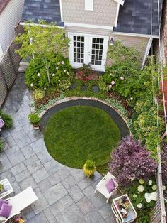 small garden with a patio like the concept of the circular lawn just a