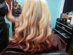 Blonde ombre with red ends.