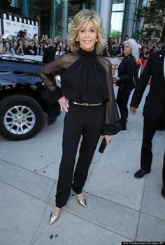 jane fonda at 76 looking stunning in a black pant suit with metallic accessories.
