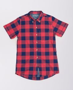 This red and navy plaid short sleeve shirt is inspired by menswear, but tailored for women. By Peau de Loup Exclusively for Wildfang.
