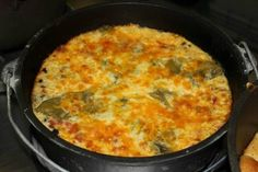 Chile Relenos Casserole 1 lb. bulk spicy pork sausage 1 onion diced 1 small can evaporated milk 1 small can water 1/2 teaspoon salt 6 eggs 1/2 cup gluten free flour 3 7 oz. cans whole green chilies seeded 3 Rudi's Gluten-Free Tortillas  3 cups grated cheese, mixed cheddar and Montrey Jack