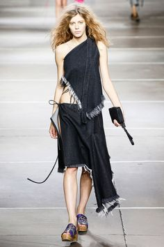 See the Marques' Almeida Spring 2015 collection on Vogue.com.
